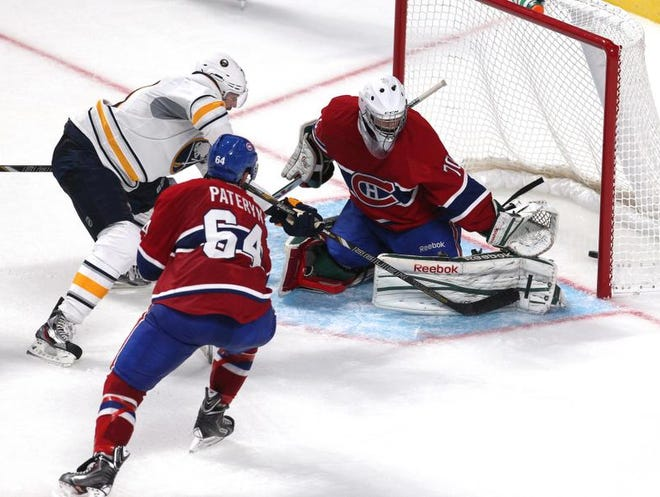 Sabres left wing Colton Gillies, left, scores a goal against Montreal on Sunday during an NHL preaseason game.