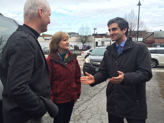 Burlington Mayor Miro Weinberger thanks Ken and Tracy Coleman on Tuesday after the couple traveled 1,400 with a Ronald McDonald statue they donated to Burlington's Ronald McDonald House.