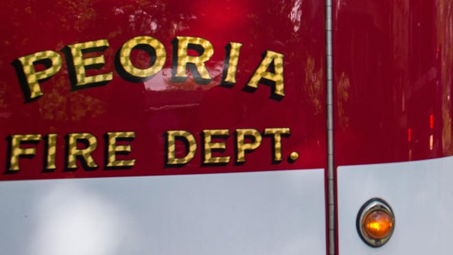 The side of a Peoria Fire Department engine is shown in a file photo.