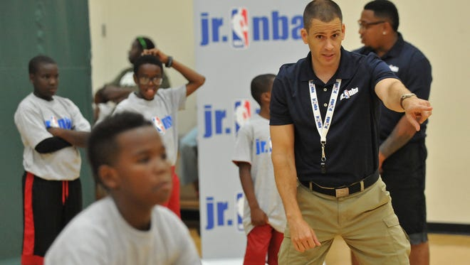 Kids dribble basketballs and participate in a Jr. NBA Clinic at Quest Multisport in Chicago.