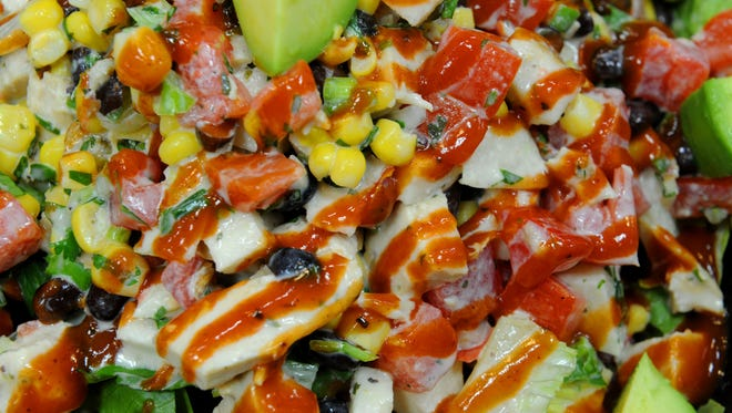The Southwestern BBQ Chopped Chicken Salad at Body Fuel Bistro in Port Hueneme. It's a new restaurant owned by mother-daughter team Angie and Hailey Wiggins. It's open weekdays from 10 am. to 9 p.m., Saturdays 10 to 7, Sundays 11 to 6. It's in the shopping center with Ralph. Owners were into fitness when they decided to concentrate on the food side of it. It's a bright, clean place done in white and black, with impressive glass-ball chandeliers high overhead.