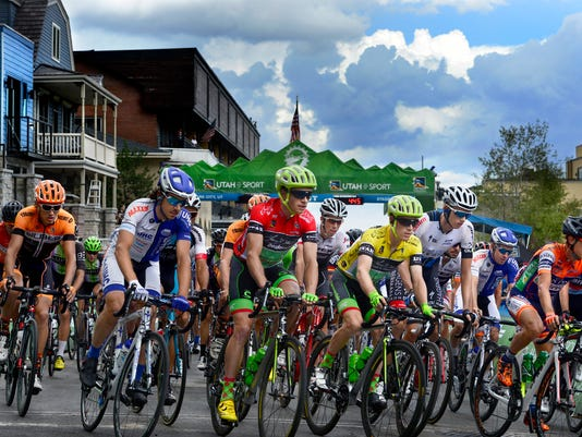 Race leader Andrew Talansky (yellow jersey) of the Cannondale-Drapac Pro Cycling Team starts out on the final stage of the Tour of Utah bicycle race as it starts on Park City's Main Street, Sunday, Aug. 7, 2016. (Scott Sommerdorf/The Salt Lake Tribune via AP)