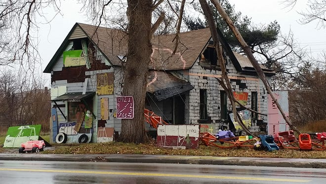 The Taxi House at the Heidelberg Project on Sunday after a fire at the home on Detroit's east side. This is the 12th building go up in flames in 18 months at the project.