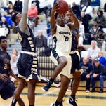 Ocoee's Wade Duffus grabs a rebound during Wednesday's regional quarterfinal game against Melbourne.
