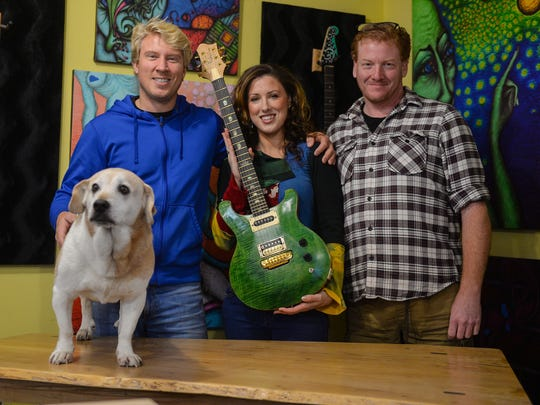 In this file photo, Nicholas Lee, left, Ariel Stevenson and Mike Palladino pose for a photo at their custom guitar shop in Lewes.