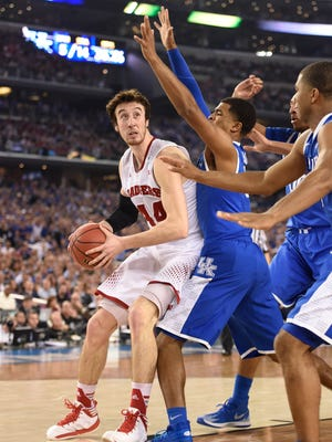 Wisconsin Badgers forward Frank Kaminsky (44) is defended by Kentucky Wildcats guard Andrew Harrison (5) in the second half during the semifinals of the Final Four in the 2014 NCAA Mens Division I Championship tournament at AT&T Stadium.