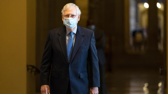 Senate Majority Leader Sen. Mitch McConnell of Ky. walks towards the Senate floor on Capitol Hill, Thursday, Oct. 1, 2020, in Washington.