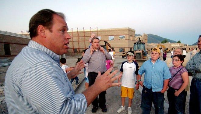 Glenn Way, a former Utah legislator, gives a tour of an American Leadership Academy campus in Spanish Fork, Utah, in 2005.