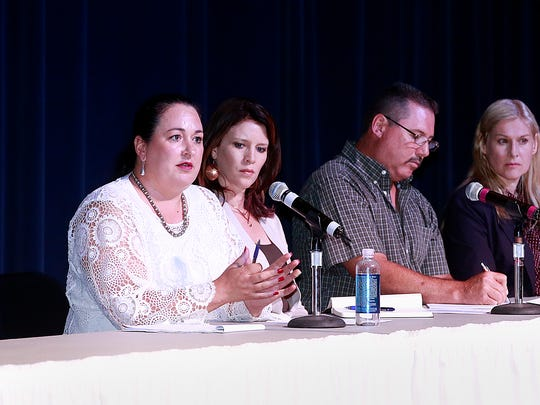 Germaine Chappelle, left, an attorney representing the AV Water company, answers questions on Thursday during a public meeting at the Farmington Civic Center.