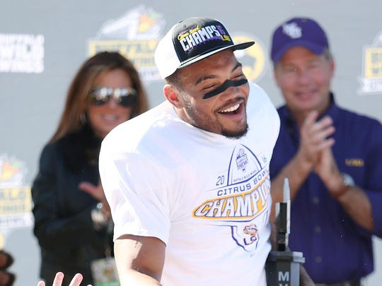 LSU running back Derrius Guice celebrates after being
