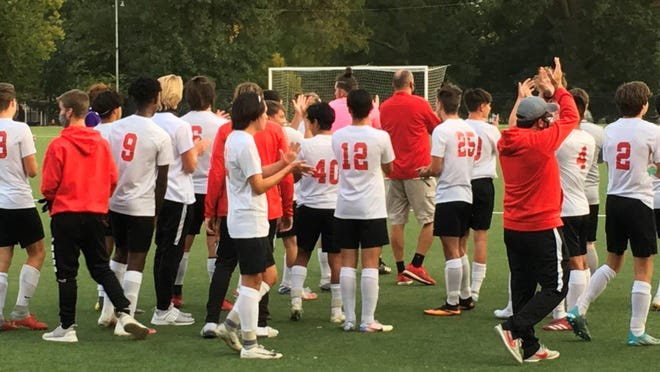 Shawnee Heights' soccer team shows its sportsmanship by applauding for Topeka West after the T-Birds' 10-0 win at Hummer Sports Park Monday night.