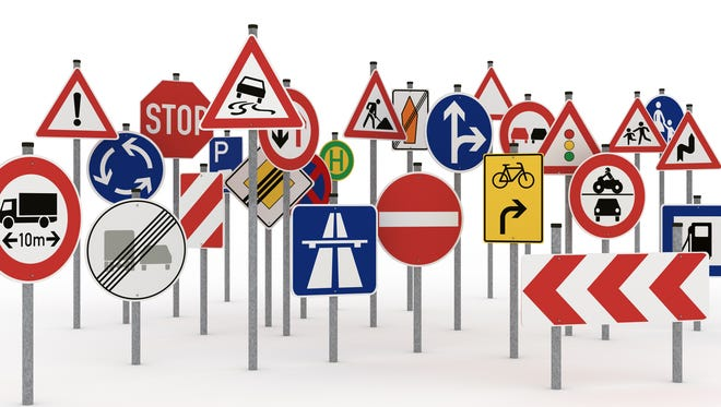 Too many traffic signs on white background - different version with selective focus please click the image blow: