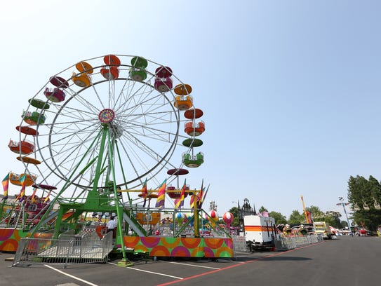 Colorful carnival rides run for a small crowd on the