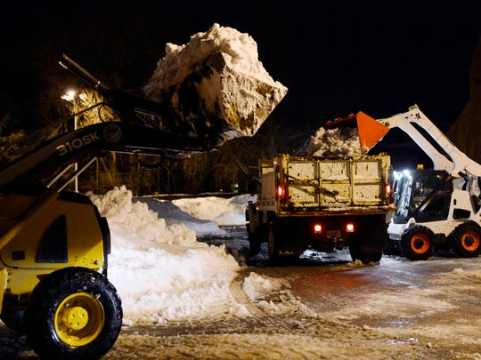 Crews remove snow from a city lot in York this week, as cleanup continues around the city.