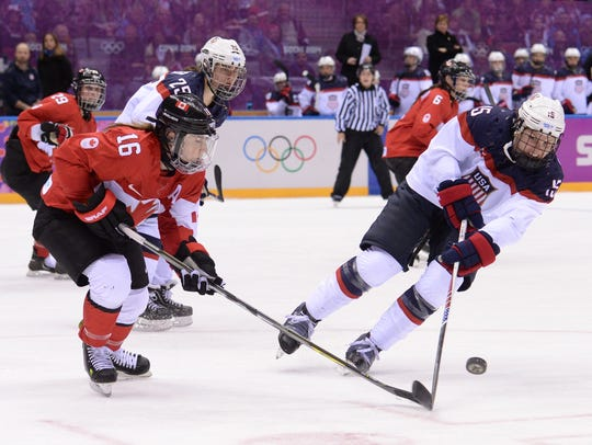 Team USA's Anne Schleper, right, vies with Canada's