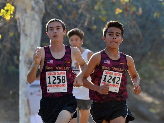 Bradley Williams and Mario Jimenez of Simi Valley run in the boys varsity race at the Coastal Canyon League cross country championships in Camarillo on Thursday.  Williams came in fifth and Jiminez finished eighth.