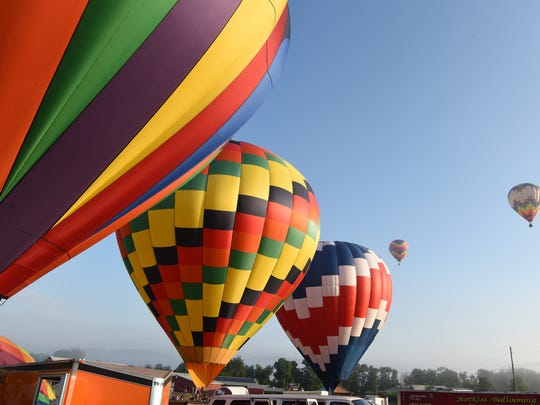 Scenes from the 6 a.m. hot-air balloon launch during the second day of the Hudson Valley Hot-Air Balloon Festival, held at Barton Orchards in Poughquag.