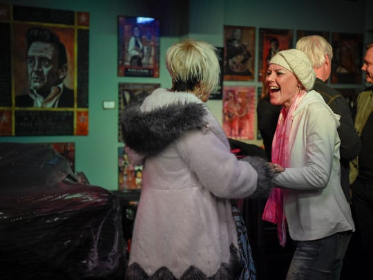 Lorrie Morgan laughs with Anita Cochran backstage during