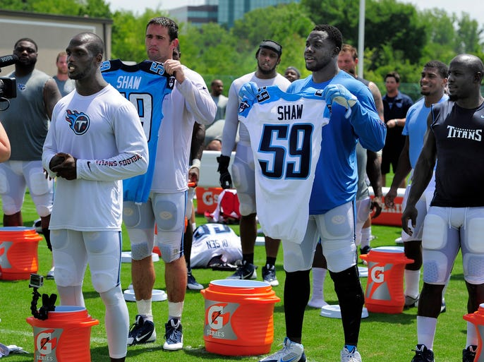 Titans cornerback Jason McCourty challenges all Titans fans to take the ALS ice bucket challenge before the team did the challenge as a group in honor of former teammate Tim Shaw after practice Wednesday, Aug. 20, 2014, at St. Thomas Sports Park in Nashville. Shaw was diagnosed with ALS in April.