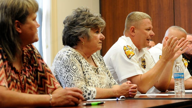 Newark Police Chief Barry Connell (right) talks about his own family's experience with addiction while sitting with Patricia Perry and Colleen Richards during a press conference Tuesday afternoon at the Newark Police Department. The two mothers of addicts joined Connell as he announced the Newark Addiction Recovery Initiative. Perry and Richards will be volunteers with the program, modeled after the PAARI program started in Gloucester, Massachusetts, in May 2015.