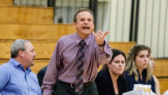 Kettle Moraine head coach Jack Hervert gestures from