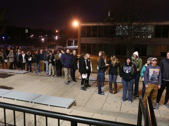 Caucusgoers line up outside of Olin Hall at Drake University