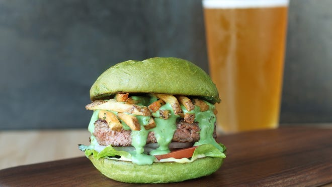 The Luck-O-The-Doddy Burger Special from Hopdoddy is a Beef Patty burger with Green Beer Cheese, Kennebec Fries, White Onion, Tomato, Red Leaf Lettuce, Sassy Sauce and a Green Egg Bun.