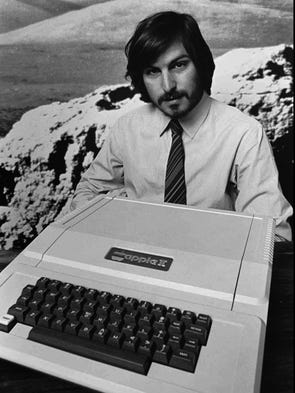 This 1977 file photo shows Apple co-founder Steve Jobs