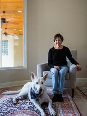 Suzanne DeBruyne with her dog, Cowboy, an 8-year-old