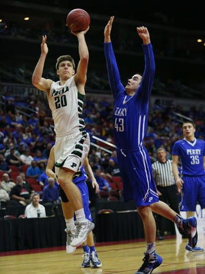 Pella's Will Warner shoots the ball during a Class 3A quarterfinal game against Perry.