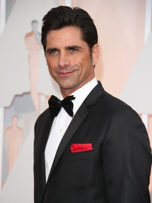John Stamos arrives at the 87th annual Academy Awards at the Dolby Theatre in Los Angeles on Feb. 22, 2015.