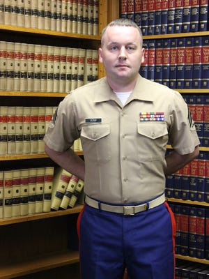 Marine Corps Sgt. Nathaniel Bump was among more than 200 veterans and active duty personnel honored through the Ziff Law Firm's Veteran of the Game program.