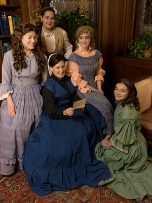 """Ruth Bellavia, seated, plays Marmee, Mrs. March, in Blackfriars' production of """"Little Women: The Musical."""" From left, are Rebecca Pfohl as Meg, Cassidy Thompson as Jo, Gemma Vodacek as Amy and Natalia Hulse as Beth."""