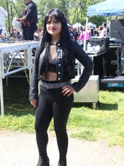Sahira Valenzuela, 25, poses in her Selena outfit Sunday at a concert paying tribute to the Tejano star, whose birthday is Monday.
