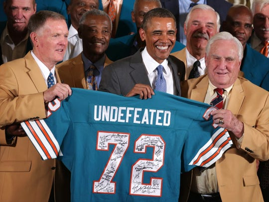 Evansville native Bob Griese (left) poses for photos with then-President Barack Obama as he hosted the 1972 Super Bowl champion Miami Dolphins on Aug. 20, 2013 at the White House. Former Dolphins coach Don Shula is on the right.