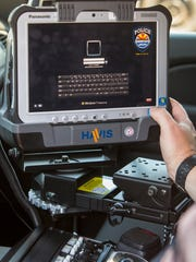 Surprise police will replace officers' laptop computers with new Panasonic Toughpad tablets.