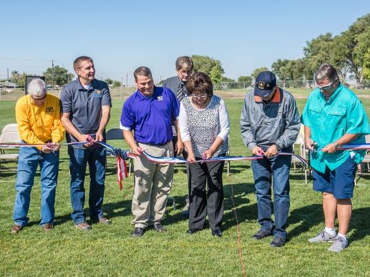 Officials participate Sept. 17 in a ribbon-cutting ceremony for the Kirtland Youth Association's new football field.