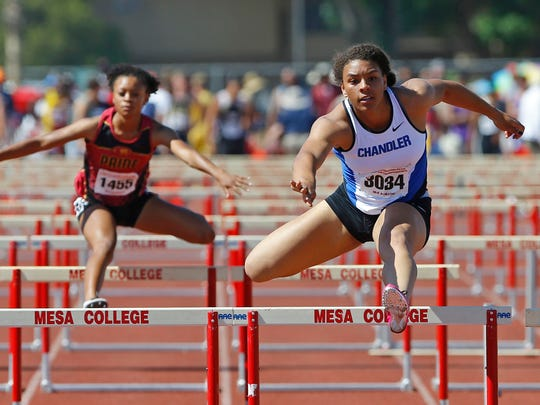 Ky Westbrook of Chandler wins the 100 meter Hurdles with a time of 14:16 during the state track and field championships at Mesa Community College Saturday, May 10, 2014 in Mesa.