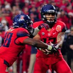 Arizona and quarterback Anu Solomon (right) are a likely preseason top 25 team but do not have the common luxury of an idle week this season.