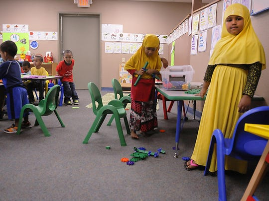 Kids play in a classroom in August at the now-closed