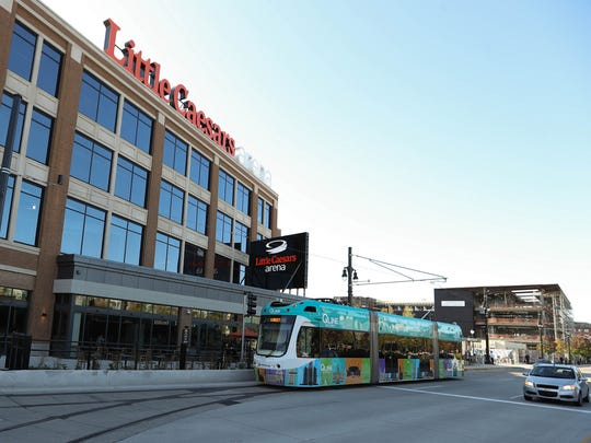 The QLINE passes in front of Little Caesars Arena in Detroit Thursday, Oct. 5, 2017.