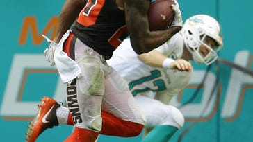 Ajayi scores in overtime, Miami tops Cleveland 30-24