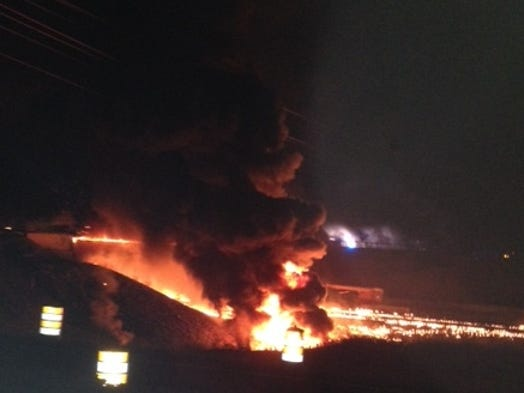 A fire burns on I-65 at Peytonsville Road following a tanker truck explosion during the early morning hours of Aug. 15, 2014.