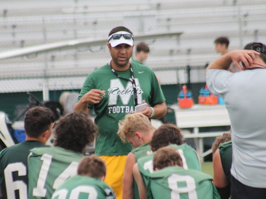 McNicholas coach Mike Orlando instructs his troops after a recent practice.  The Rockets will host their first-ever game under the lights at Penn Station Stadium on Aug. 24 against Goshen.