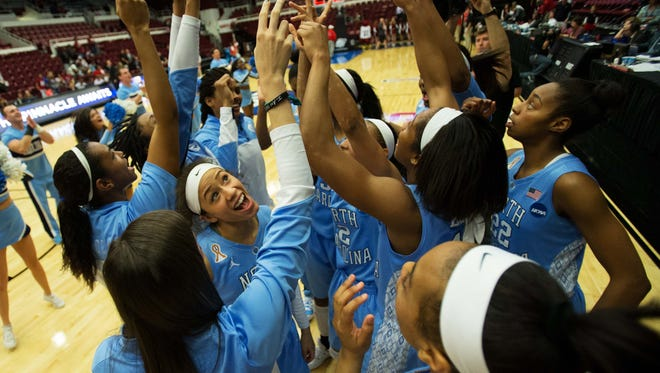 North Carolina Tar Heels guard Jessica Washington (24) celebrates with teammates after the win against the South Carolina Gamecocks in the semifinals of a women's college basketball game in the Stanford regional of the 2014 NCAA Tournament at Maples Pavilion.