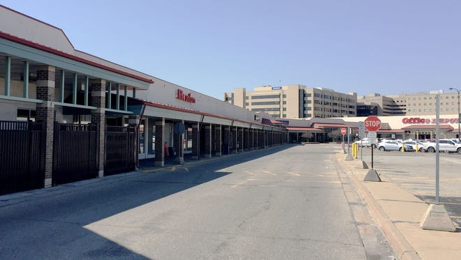 Beaumont Health has announced plans to demolish the Northwood shopping center and surrounding buildings to make way for future redevelopment. This includes Kroger, Firestone and 28 row houses at the southwest corner of 13 mile and Woodward in Royal Oak. Picture taken April14, 2016.