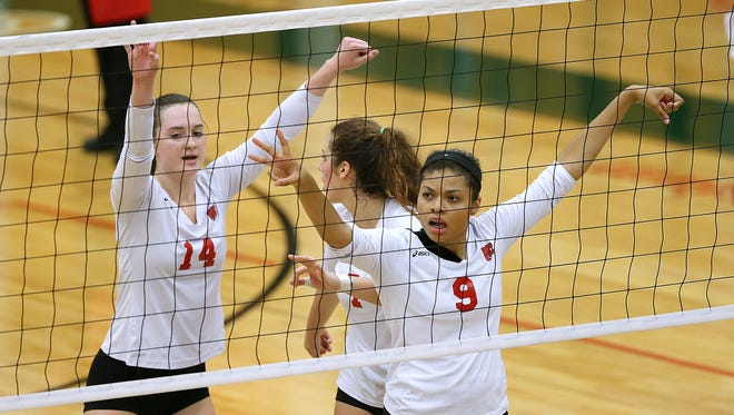 Lawrence North waits for the serve from Cathedral in the second of five sets during action at Lawrence North High School, Indianapolis, Thursday, September 8, 2016.