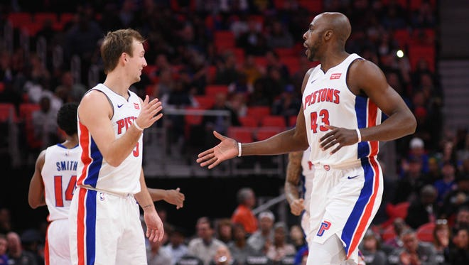 Pistons forward Anthony Tolliver (43) high fives guard Luke Kennard (5) during the second quarter on Wednesday, Nov. 29, 2017, at Little Caesars Arena.