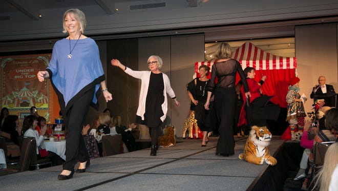 Cancer survivors walk the runway for the finale of Celebration of Life Fashion Show.