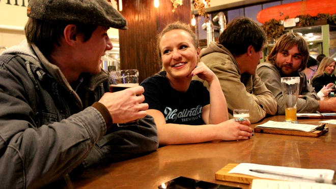 Jesse Arnold, left, chats with Anisa Dahm at the Playalinda Brewing Company in Titusville.